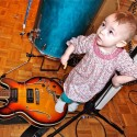 noemi likes to stand on my aria archtop guitar